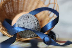 Threads and ribbon. Composition  with grey threads and blue ribbon Stock Photography
