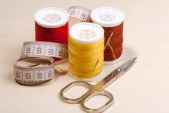 Threads and scissors Stock Image