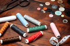 Threads, scissors and buttons Royalty Free Stock Photos