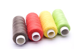 threads for sewing on a white background Royalty Free Stock Photo