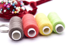 Threads for sewing on a white background Stock Photography