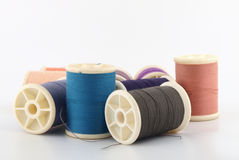 Threads in spools on white Stock Photo