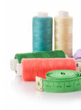 Threads and tape measure tools for fancywork. On white background Royalty Free Stock Photography