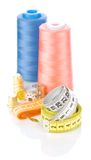 Threads and tapelines with spools and timbles Stock Image