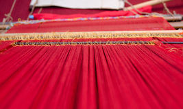 Threads to fabric. The loom machine for making traditional songket Royalty Free Stock Images