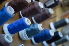 Threads at a workshop. Different tailor threads in a workshop Royalty Free Stock Photography