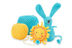 Threads yellow and blue and toys. Yellow and blue toys and threads the same colors. Isolated on white Stock Photos