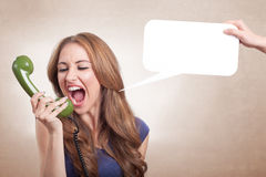 Threat. A young girl is threatening to someone over the phone royalty free stock photography