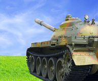 Threat Of War. (Military Tank On Green Grass Against Blue Sky Royalty Free Stock Image