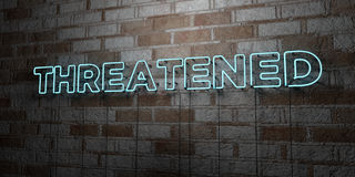 THREATENED - Glowing Neon Sign on stonework wall - 3D rendered royalty free stock illustration Stock Photos