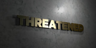 Threatened - Gold text on black background - 3D rendered royalty free stock picture Stock Photos