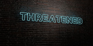 THREATENED -Realistic Neon Sign on Brick Wall background - 3D rendered royalty free stock image Royalty Free Stock Photos