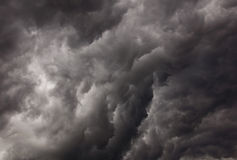 Threatening clouds. Large black clouds a storm are threatening stock image