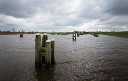 Threatening clouds above a Dutch river Stock Photos