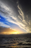 Threatening clouds on the horizon. Layers of clouds threatening on the horizon at sunset is approaching. Sicily is hidden Royalty Free Stock Photo