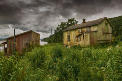 Threatening clouds. Over the old abandoned house Stock Photo
