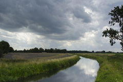 Threatening sky over a river Royalty Free Stock Photo