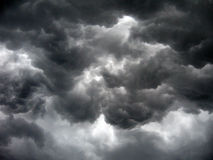 Threatening thunderstom clouds over the earth Stock Photo