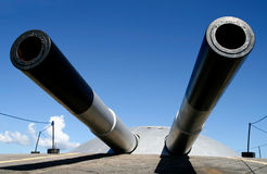 Threatening Weapons. Big cannons on top of a fortress in Copacabana, Rio de Janeiro, Brazil Royalty Free Stock Image