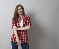 Threatening woman with male shirt expressing self-assertion Royalty Free Stock Images