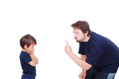 Threating father. A father is threating his little boy with a finger Royalty Free Stock Photo