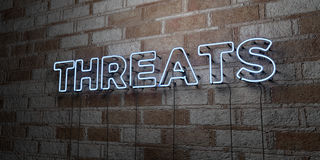 THREATS - Glowing Neon Sign on stonework wall - 3D rendered royalty free stock illustration Royalty Free Stock Image