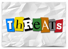 Threats Word Cut Out Letters Ransom Note Risk Danger Warning. Threats word in cut out letters on a note like a ransom or kidnapping message to illustrate a Royalty Free Stock Photography