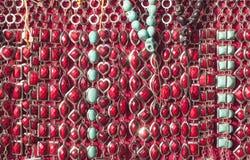 Threds della perla in tonalità di rosso Fotografia Stock