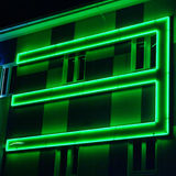 Three. A green three light at the facade stock photos
