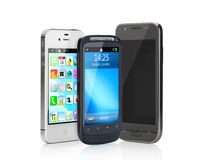 Three. Close up view of modern mobile phones  on white back Royalty Free Stock Image