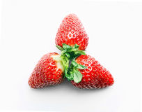 Three strawberries on the white background Royalty Free Stock Images