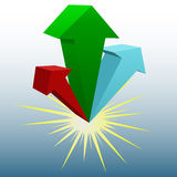 Three 3D arrows explode up in red, blue, green. A set of red, blue and green 3D arrows explode up from a flash Royalty Free Stock Image