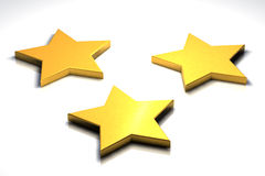 Three 3d golden stars. On white surface Royalty Free Stock Photos