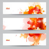 Three abstract artistic headers with paint splats. Three abstract artistic banners with orange dot paint splats Stock Images