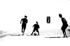 Three Abstract Soccer Players. Black and white abstract child soccer players Royalty Free Stock Photos