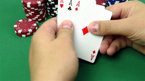 Three ace. In hand and poker chips stack stock video