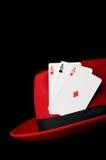 Three aces on felt hat, isolated on black Stock Images