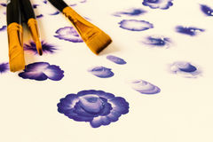 Three acrylic paint flat brushes. Basic one stroke painting, painting stroke explained for beginners. Hand drawn folk blue flowers. Three acrylic paint flat Stock Images