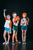 Three active kids in sportswear posing with sport equipment royalty free stock images