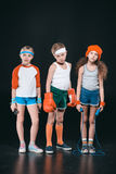Three active kids in sportswear posing with sport equipment royalty free stock photo