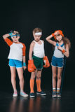 Three active kids in sportswear posing with sport equipment royalty free stock photography