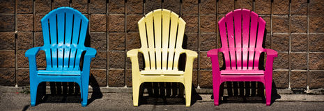Three adirondack chairs Royalty Free Stock Images