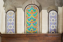 Three adjacent arched stained glass windows Royalty Free Stock Photo