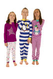 Three adorable children wearing colorful winter pajamas yawning Stock Photography