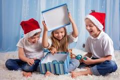 Three adorable kids, preschool children, siblings, having fun fo Stock Photography