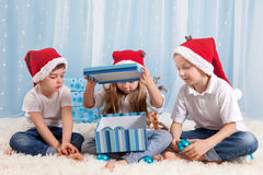 Three adorable kids, preschool children, siblings, having fun fo Royalty Free Stock Photos