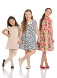 Three adorable little girls holding hands Royalty Free Stock Images