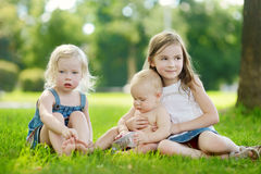 Three adorable little kids having fun outdoors Royalty Free Stock Photos