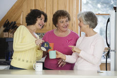 Three adult women talking stock photos