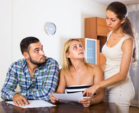 Three adults with papers Stock Photo
